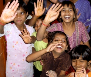 Waving girls in orphanage 2005-11-17 India II 108